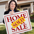 House and WomHolding Sold Home Sign — Stock Photo #2358651