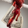 Wrinkled Dollar Tied Up and Bleeding — Stock Photo