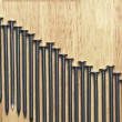 Declining Graph of Nails on a Wood — Stock Photo
