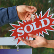 Royalty-Free Stock Photo: Handing Over the Keys and Sold Real Estate Sign