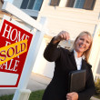 Real-Estate Agent Handing Over Keys — Stock Photo