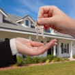 Handing Over Keys in Front of Home — Stock Photo