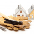 Hammer, Gloves, Nails, Houses on White — Stock Photo