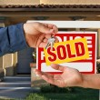 Handing Over Keys, Sold Sign and House — Stock Photo
