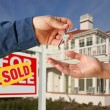 Stock Photo: Handing Over Keys, Sold Sign and House