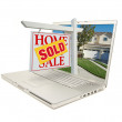 Постер, плакат: Red Sold Home For Sale Sign on Laptop