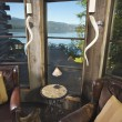 Royalty-Free Stock Photo: Luxurious Rustic Reading Room with Lake View