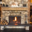 Rustic Fireplace in Log Cabin - Photo