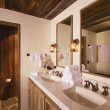 Luxurious Rustic Bathroom with Mining Lamps - Stock Photo