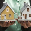 Stock Photo: Two Model Houses in Female Hands