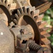 Vintage Rusty Farm Equipment Gears - Stock Photo