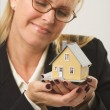 Woman Holding Model House — Stock Photo
