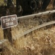 Stay on Trail Sign on Wooden Fence — Stock Photo