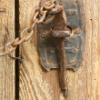 Antique Rusty Barn Door Latch and Chain - Stock Photo