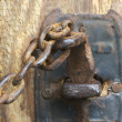 Stock Photo: Antique Rusty Barn Door Latch and Chain