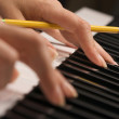 Womans Fingers on Digital Piano Keys — Stock Photo #2359720