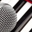 Royalty-Free Stock Photo: Microphone Laying on Electronic Keyboard