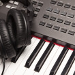 Headphones Laying on Electronic Keyboard - Stock Photo