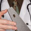 Doctor with Hand Saw — Stock Photo