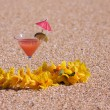 Tropical Drink on Sandy Beach Shoreline - Stock Photo