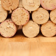 Stack of Wine Corks on a Wood Surface. - Stock Photo