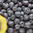 Stock Photo: Macro Kiwi and Blueberries Background