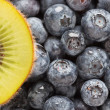 Macro Kiwi and Blueberries Background — Stock Photo