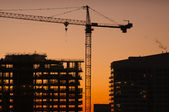 Silhouette of Crane and Building — Stock Photo