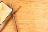 Chop Sticks, Bowl and Bamboo Background — Stock Photo