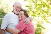 Loving Senior Couple Enjoying Outdoors Together — Stock Photo