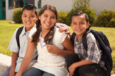 Cute Brothers and Sister in Backpacks — Stock Photo