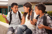 Hispanic Kids at School with Backpacks — Stockfoto