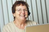Smiling Senior Adult with Telephone Headset — Stock Photo