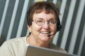 Smiling Senior Adult and Phone Headset — Stock Photo