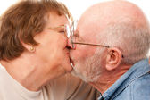 Affectionate Senior Couple Kissing — Stock Photo