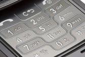 Gri detaylı cep telefonu numara pad makro — Stok fotoğraf