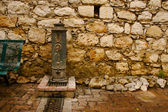 Ancient Brick Wall and Water Pump — Stockfoto