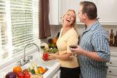 Happy Couple Enjoying An Evening Preparing Food — Stock Photo