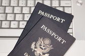 Two Passports on a Laptop Computer — Stock Photo