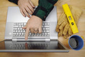 Contractor Reviews Project on Laptop — Stock Photo