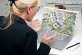 Excited Woman In Kitchen Using Laptop to Earn or Win Money — Stock Photo
