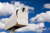 Weathered Old Mailbox Against Blue Sky and Cloud — Stock Photo