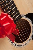 Guitar and Strings with Red Ribbon — Stok fotoğraf