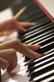 Woman Playing Digital Piano with Pencil — Stock Photo