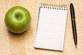 Pen, Paper and Apple on Wood — Stock Photo