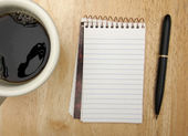 Cup of Coffee, Blank Pad and Pen on Wood — Stock Photo