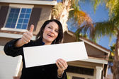 Front of House, Lady with Blank Sign — Stock Photo
