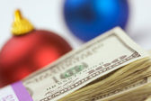 Money and Christmas Ornament on White — Stock Photo