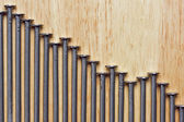 Declining Graph of Nails on Wood — Stock Photo