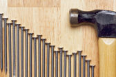 Hammer and Declining Graph of Nails — Stock Photo